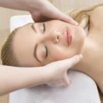 Woman getting a relaxing massage in a spa - head